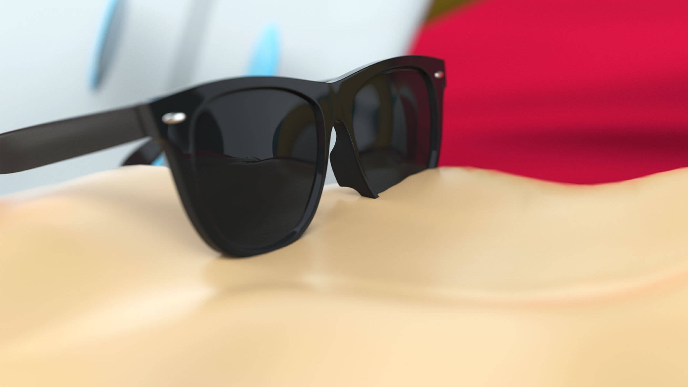 Rayban glasses in the sand
